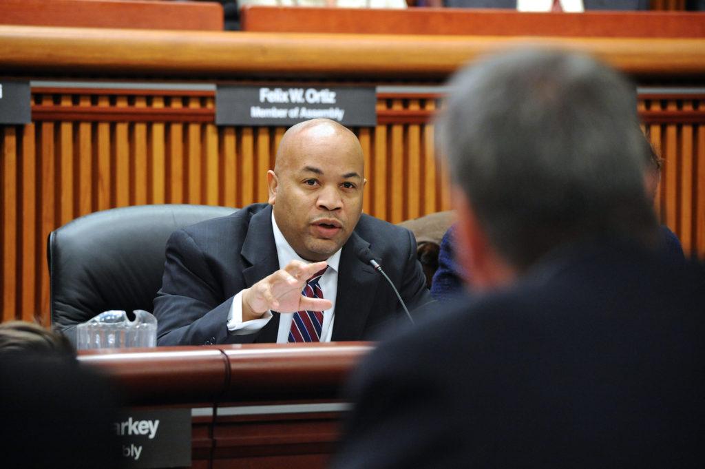 new york legislator at dais talking to witness